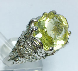 Ring with  lemon quartz, 6,6 ct. and 16 cz-diamonds