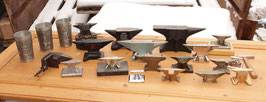 # high valueable group of collectors anvils , anvil / blacksmith tin cups and paperweights and piggy bank , watchmaker anvils