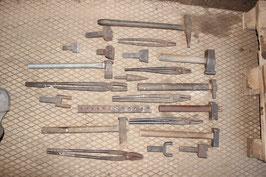 # set of blacksmith tongs , hardys , etc as on fotos