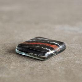 Cabujon grande diseño Piedra, colores negro, blanco y naranja, 25mm