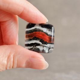 Cabujon diseño Piedra, colores negro, blanco y naranja