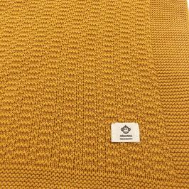 Strickdecke mit schönem Muster , Farbe senfgelb