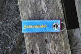 """Schlüsselanhänger, rot/blau, gelb, """"Schietbüdel"""""""