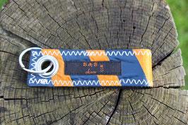 Schlüsselanhänger, schwarz/orange, grau