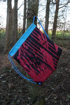 Turnbüdel aus Kite, hellblau, schwarz, rot, hellblaue Schnur, Liquid Force