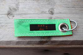Schlüsselanhänger, orange/schwarz, grün