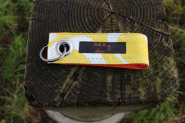 Schlüsselanhänger, orange/gelb, weiß