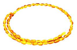 Bernstein Perlen honigfarbene ovale Nuggets ca. 5-6 mm lang Strang
