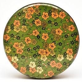 Groen rond koekblik met oranje/goud/zwarte bloemen