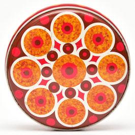 Rood blik met rode/bruine/oranje cirkels en stippen