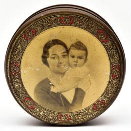 Blik met foto van moeder en dochter
