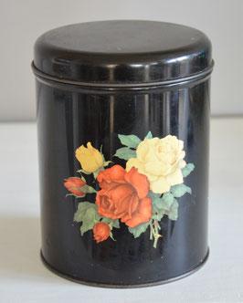 Zwart blik met gele en rode roosjes