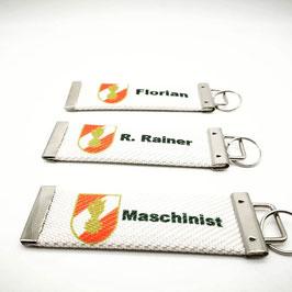 Schlüsselanhänger mit 3D Korpsabzeichen und deinem Wunschtext auf echtem Feuerwehrschlauch