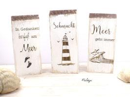Holzhaus mit maritimen Spruch für alle Meerliebhaber -