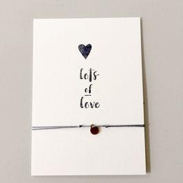"Karte ""lots of love"" mit Armband"