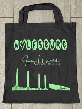 Stofftasche, schwarz mit grünem Aufdruck.