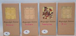 Weiße Tafel Schokolade mit Himbeere, Maracuja, Rosenblüten oder Zimt