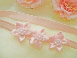 Kopfband rosa mit Satinblüten