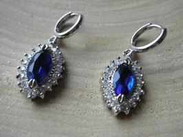 Edle Ohrhänger mit funkelndem blauem Kristall