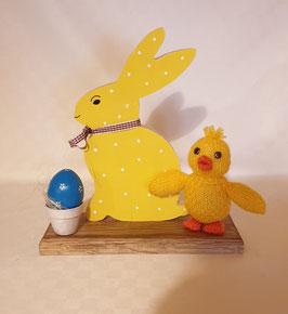 Lapin de Pâques et poussin et cocotier