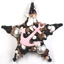 Stern mit rosa Anker auf schwarz-weißen Glaskugeln