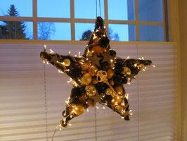 Großer Stern in gold-schwarz, beidseitig mit Licht