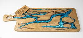 Eichenbrett in Lichtenberg Technik und Epoxidharz in aqua mit selbstkreiertem Holzgriff