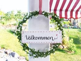 """Holzschild """"Välkommen"""" - mit Blütenkranz (weiße Blüten)"""