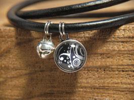 Klingeling Armband mit schwarz-weißem Bild an schlicht, schwarzem Leder