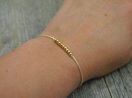 Armbändchen mit goldenen Kugeln gelbes Armband