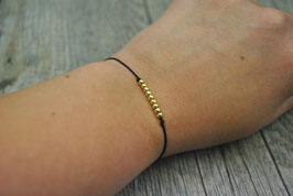 Armbändchen mit goldenen Kugeln schwarzes Armband