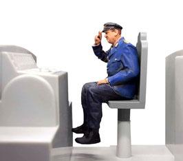 Lokführer sitzend