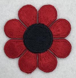 Rode bloem met zwarte ronde binnenkant applicatie