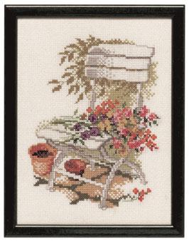Borduurpakket van een tuinstoel met bloemen.