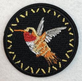 Zwart rondje met een kolibrie applicatie