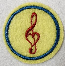 Rode muziek noot op een geel rondje applicatie