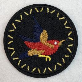 Zwart rondje met een rood vogeltje applicatie