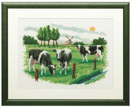 Borduurpakket van koeien in de wij.