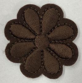 Bruine ronde basis bloem applicatie