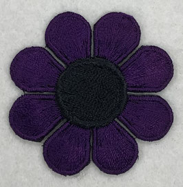 Paarse bloem met zwarte ronde binnenkant applicatie