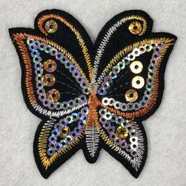 Pailletten vlinder applicatie oranje