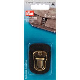 Insteeksluiting brons kleur op donker bruin leer bevestigd.