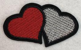 Roode en zilveren hartjes met zwarte rand applicatie