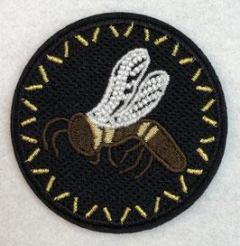 Zwart rondje met een bruine bij met witte vleugels applicatie