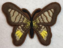 Applicatie vlinder bruin met een zwart lijf