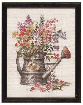 Borduurpakket van een gieter met bloemen.