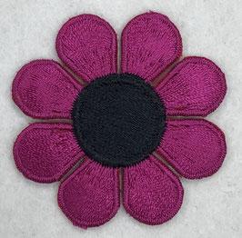 Roze bloem met zwarte ronde binnenkant applicatie