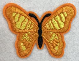 Applicatie vlinder oranje met een zwart lijf