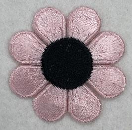 Lichtroze bloem met zwarte ronde binnenkant applicatie