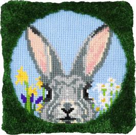 Vrolijk konijn kruissteek/knoopborduurkussen.